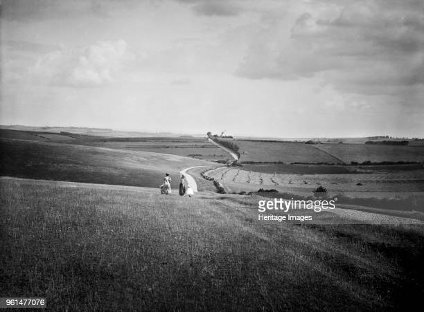 Windmill Hill, West Ilsley Downs, Berkshire, 1890s. Women and children walking in the beautiful landscape of the West Ilsley Downs. A meandering path...
