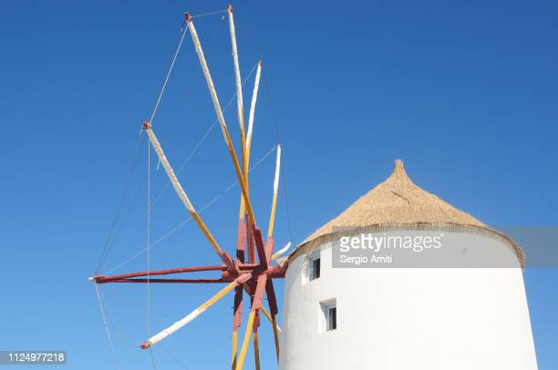windmill in santorini - traditional windmill stock photos and pictures