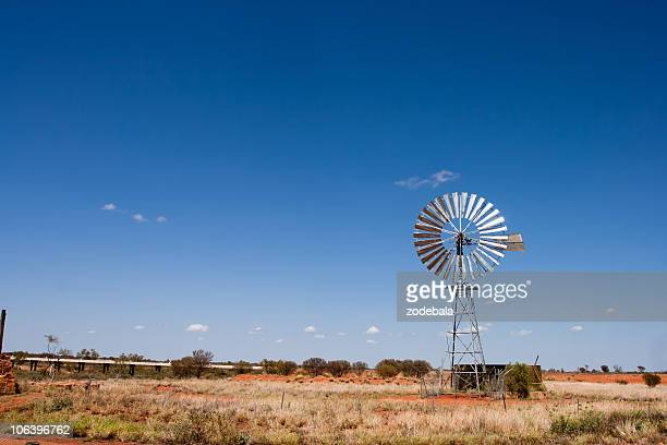 windmill in the outback,rural australia - queensland stock pictures, royalty-free photos & images