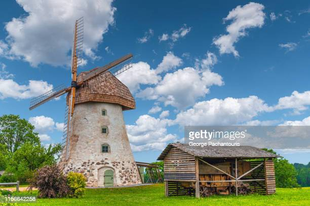 windmill on a farm in latvia - latvia stock pictures, royalty-free photos & images