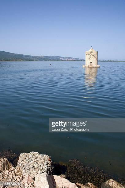 windmill on lagoon of orbetello - orbetello bildbanksfoton och bilder