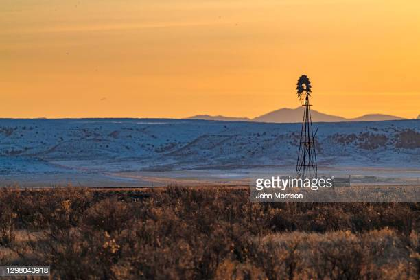 windmill on northern prairie - grass area stock pictures, royalty-free photos & images