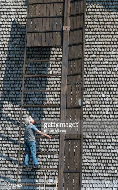 Windmill owner Detlef Sommerfeld stands on a wing the post mill in Wilhelmsaue Germany 12 May 2016 The post mill was built between 1883 and 1884 and...
