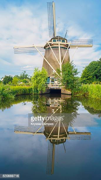 Windmill reflecting in still canal