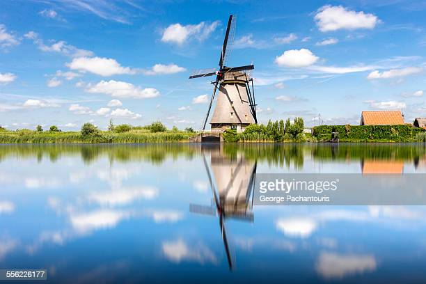 Windmill reflection on water