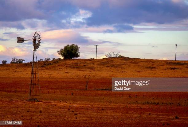 A windmill stands in a droughtaffected paddock on September 18 2019 located on the outskirts of Dubbo Australia Regional Australian towns are...
