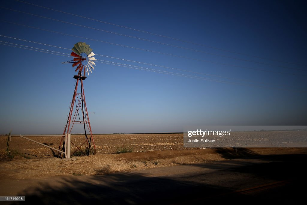 A windmill stands in an unplanted field on September 5, 2014 in Chowchilla, California. As California suffers through a third straight year of drought, the state's reservoirs are at record lows and a large number of fields in the central valley sit unplanted.