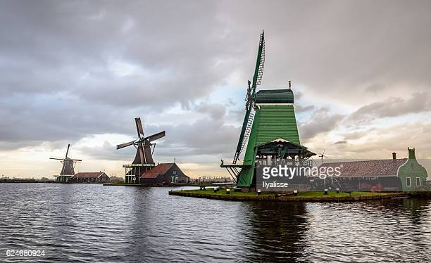 Windmills against a cloudy sky in Zaanse Schans, the Netherlands