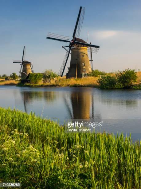 Windmills along river, Kinderdijk, Netherlands
