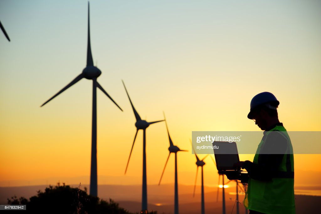 Windmills and Worker : Stock Photo