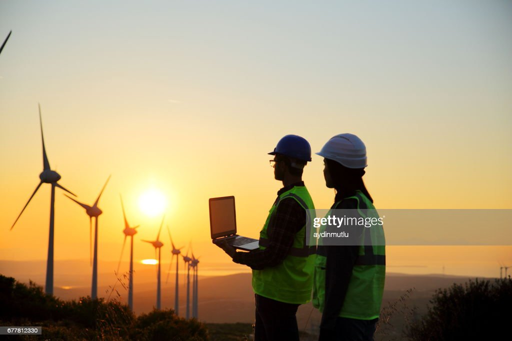 Windmills and Workers : Foto de stock
