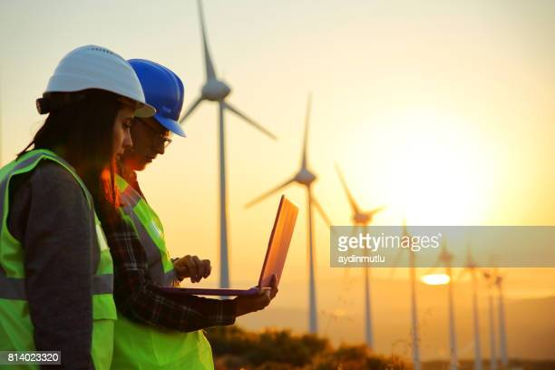 windmills and workers - windmills stock photos and pictures
