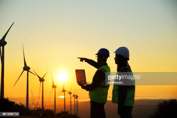 windmills and workers - power occupation stock photos and pictures