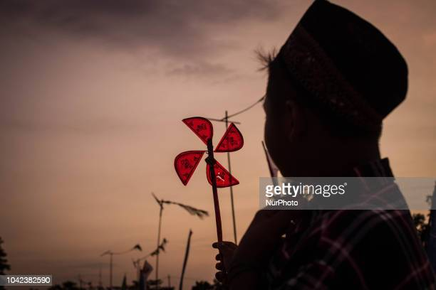 Windmills are seen during Traditional Windmill Festival on September 28 2018 in Tanjung Lesung Banten province of Indonesia The festival was attended...