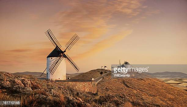 windmills at sunset, consuegra, castilla la mancha, spain - spain stock pictures, royalty-free photos & images