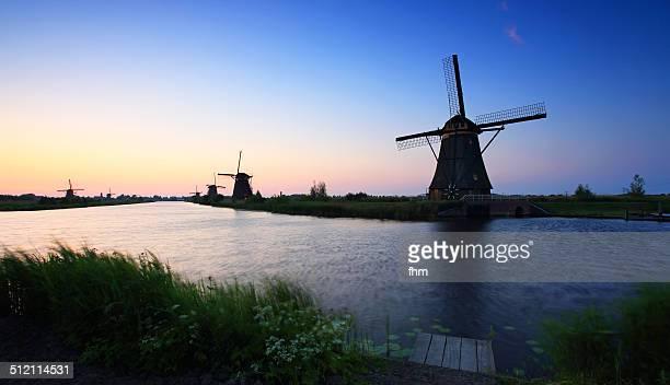 windmills at sunset - キンデルダイク ストックフォトと画像