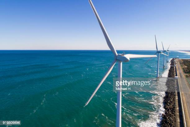 windmills by the sea - 風力発電 ストックフォトと画像
