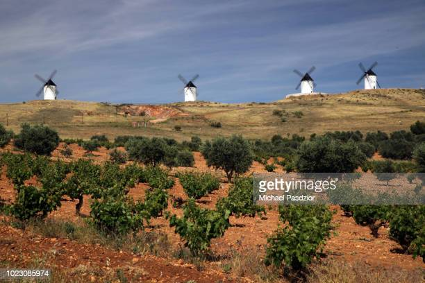windmills in la mancha - traditional windmill stock photos and pictures