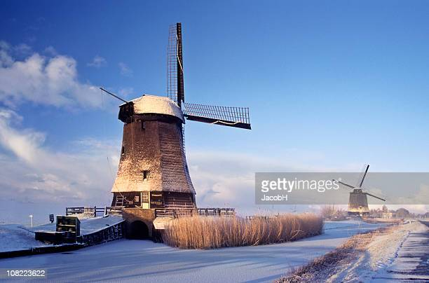 windmills in winter - old windmill stock photos and pictures
