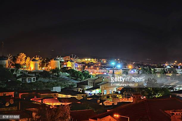 windmills of alacati at night - emreturanphoto stock pictures, royalty-free photos & images
