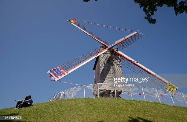 windmills of bruges - hugh threlfall stock pictures, royalty-free photos & images