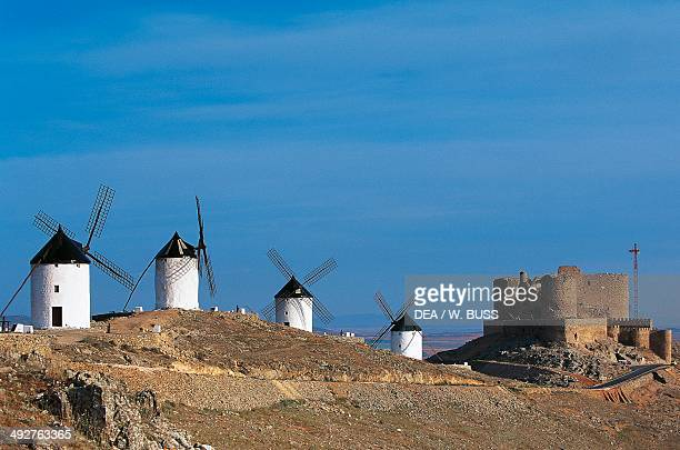 Windmills of Consuegra where the scene of Don Quixote's fight against the windmills is set with Castle of Consuegra in the background CastillaLa...