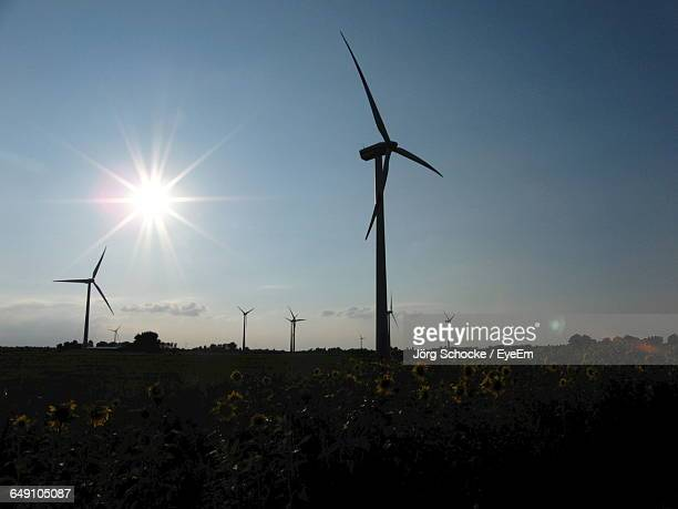 windmills on field - american style windmill stock pictures, royalty-free photos & images