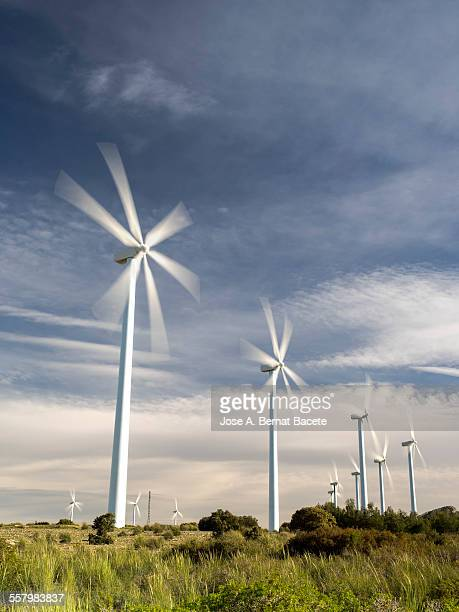 Windmills on rolling hills