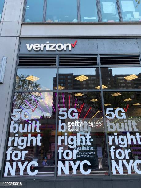 A window advertising 5G network is displayed at a Verizon store during the coronavirus pandemic on April 21 2020 in New York City ShelterInPlace and...