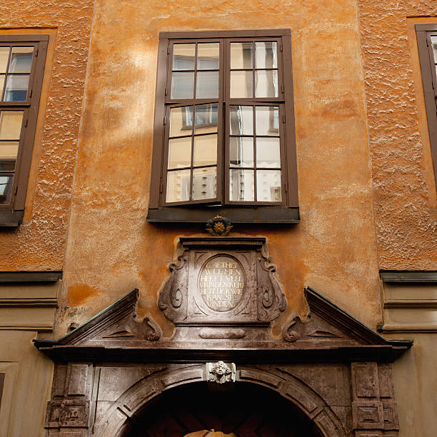 A Window Ajar Above The Doorway Of A Building In Old Town