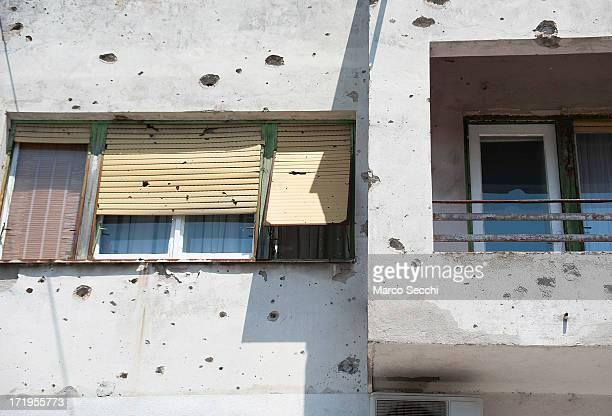 A window and a concrete wall is damaged by bulletts from the 1993 war as the city of Mostar remembers the 1993 conflict on June 28 2013 in Mostar...