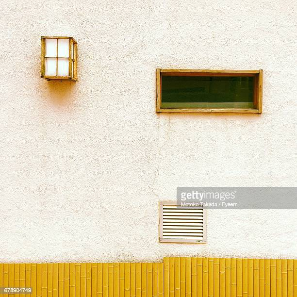 Window And Air Duct On Wall Of Building