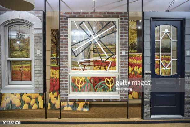 Window and door samples stand on display in the showroom of the Pella Corp manufacturing facility in Pella Iowa US on Thursday Feb 22 2018 The US...