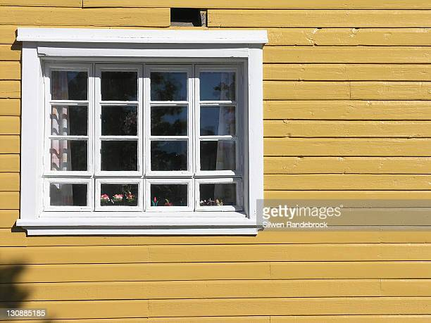 Window and yellow wooden house facade Tampere Finland