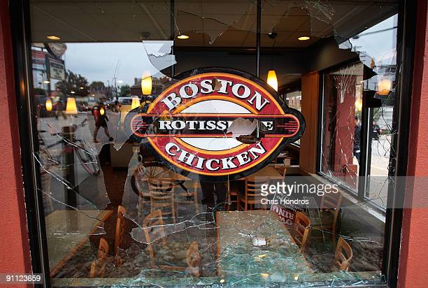 A window at a Boston Market fast food restaurant is shown shattered after during demonstrations by antiG20 Summit protestors September 24 2009 in...
