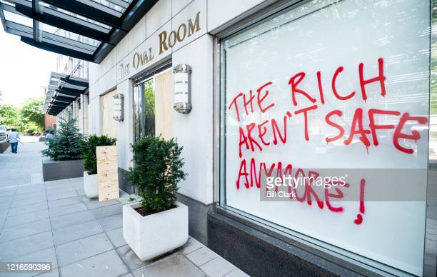 A window at the Oval Room near the White House is spray painted with the words The Rich Arent Safe Anymore on Sunday May 31 after a night of George...