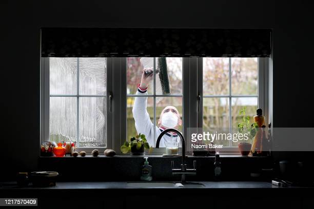 Window Cleaner at work as he wears a face mask while carrying out his work on April 08 2020 in Southampton United Kingdom There have been around...