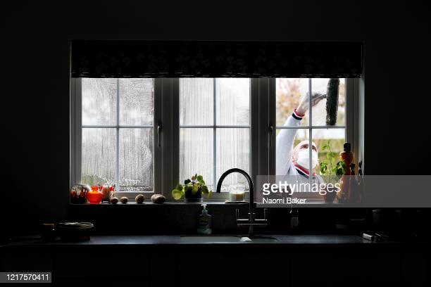 Window Cleaner at work as he wears a face mask while carrying out his work on April 08, 2020 in Southampton, United Kingdom. There have been around...