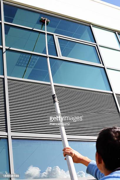 Window cleaner cleaning the windows