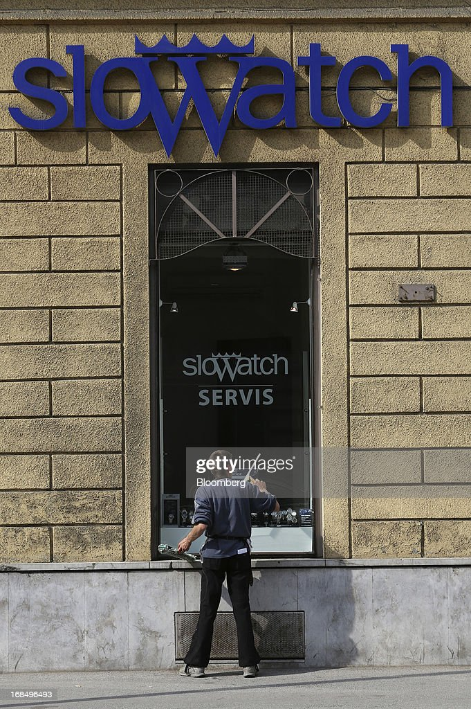 A window cleaner washes the window of a Slowatch watch store in Ljubljana, Slovenia, on Thursday, May 9, 2013. The Adriatic nation is seeking to fix its ailing lenders with a cash injection of at least 900 million euros ($1.17 billion) after Cyprus's bailout focused investors on countries with weak banking industries. Photographer: Chris Ratcliffe/Bloomberg via Getty Images