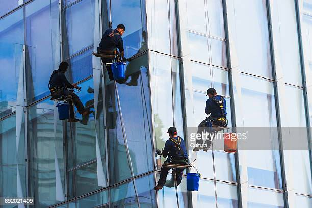 window cleaners cleaning windows of skyscraper, brooklyn, new york, usa - window cleaning stock photos and pictures