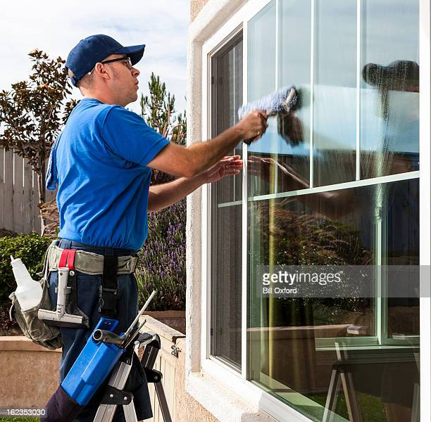 window cleaning - janitor stock photos and pictures