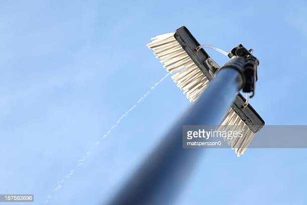 window cleaning using the water fed pole system - window cleaning stock photos and pictures