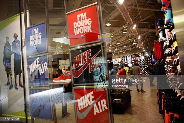 A window display advertises Nike shoes at the House Of Hoops by Foot Locker retail store at the Beverly Center in Los Angeles California US on...