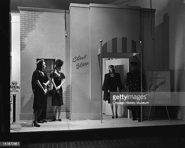 Window Display at Marshall Field & Company with a military theme, 28 shop, chic-short-cut for dancing, Chicago, Illinois, October 6, 1943.