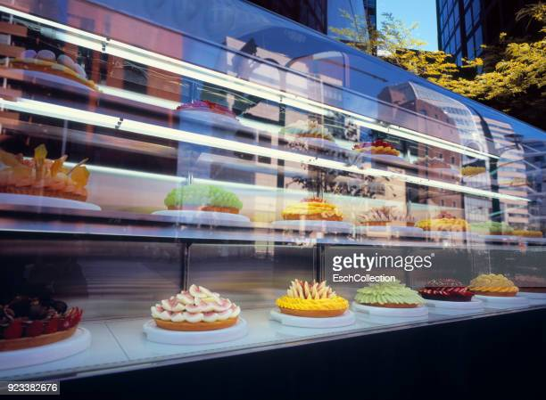 Window display of bakery with colorful fruit cakes