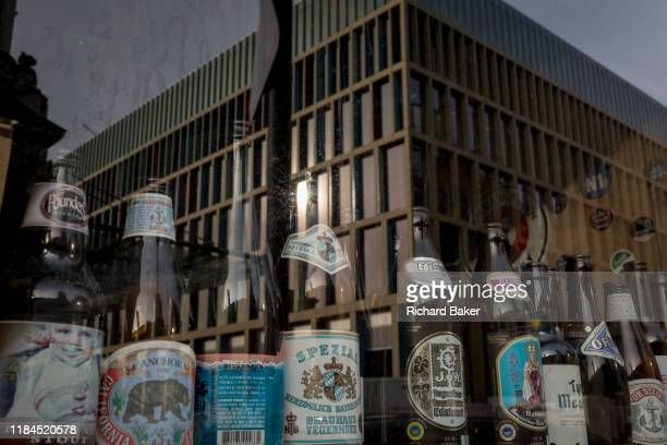 A window display of beer bottles and new architecture of an office workplace on 20th November 2019 at Smithfield in the City of London England