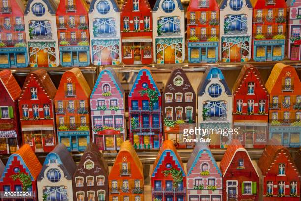 Window display of chocolate tins as houses in the town of Brugge, Belgium