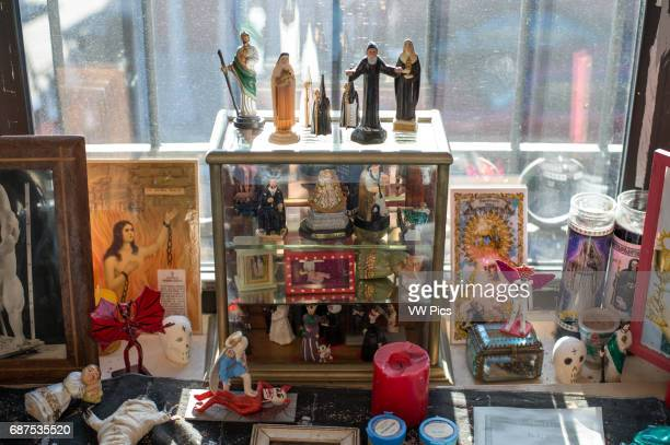 Window display of deathcentric and religious figures at the Morbid Anatomy Museum in Brooklyn New York USA