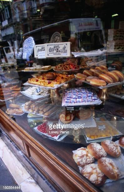 Window display of pastries at Casa Mira shop, Sol.